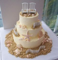 Beach Wedding Cake with Brown Sugar as Sand, SeaShells, White Fences and Two White Beach Chairs on Top