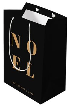 """Simple, stylish & bold """"Noel"""" quote art holiday gift bag in elegant gold on a luxe black background in modern minimalist typographic style. The greeting, family name & year can be easily personalised for a unique and personal holiday design which stands out from the crowd! #noel #blackandgold #christmas Quote Art, Art Quotes, Holiday Cards, Holiday Gifts, Customizable Gifts, Elegant Chic, Gold Christmas, Medium Bags, Etiquette"""