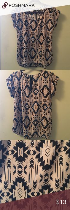 Tahiti blouse Capped sleeves. Silky blouse. Not stretchy and runs a little small. Black and Tan. Pink Rose Tops Blouses