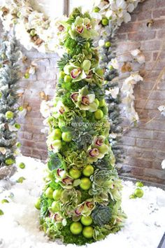 pretty little Christmas tree.This says: How cool is this fresh floral tree from the empty vase? Christmas Floral Designs, Christmas Flowers, All Things Christmas, Christmas Holidays, Christmas Arrangements, Christmas Centerpieces, Floral Arrangements, Christmas Decorations, Wreaths
