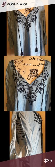 Crown & Ivy 2X Bohemian style Top This is an adorable Bohemian style top from Crown & Ivy. Sold in high end department stores like Belk & Macys. Length 32 inches , hips 64 inches chest 54 inches around. It is 100% Tencel lyocell blend. Super soft. The main color is light blue trimmed in a nave blue thread. The front has tassels that ties if you like and the sleeves are peek-a-boo with a tassels at the end. This is a beautiful top. Would be beautiful for Spring. Add a pair of white pants and…