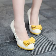Cute shoes, love the short heel and yellow details!