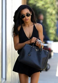Beautiful: Naya Rivera, who plays Glee's Santana Lopez, reported to the Los Angeles set for a promotional photo shoot in a skimpy jumpsuit Monday