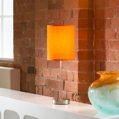 Orange fabric shade table/desk lamp/light bedside modern new 852.  A truly stunning item featuring heavy polished chrome stem and base with a beautiful fine cotton shade.  Made by Europe's top lighting manufacturer, please do not confuse with cheap Asian copies.  Available in a whole range of colours.  Matching standard lamps also available.