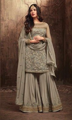Shop online from a wide collection of bollywood salwar kameez. Grab this net palazzo designer salwar kameez online. Pakistani Dress Design, Pakistani Designers, Pakistani Outfits, Pakistani Party Wear, Designer Salwar Kameez, Indian Salwar Kameez, Pakistani Sharara, Churidar, Designer Anarkali