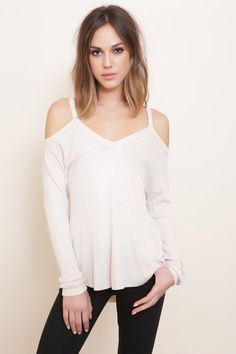 Knit v-neck top. Long sleeves with shoulder cut outs. Style #: T2405C Material: Rayon/Spandex Color: Nude Model is wearing a small