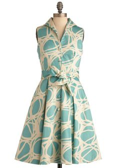 vintage-inspired frock by Lesley Evers, which features a scribbled pattern of creme against an aquamarine-hued background