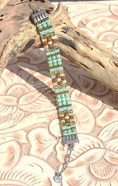 New Design! Chili Rose Petite Earth & Water Beaded bracelet!http://www.cowgirlkim.com/chili-rose-extraordinary-black-rust-and-turquoise-beaded-bracelet-9722.html