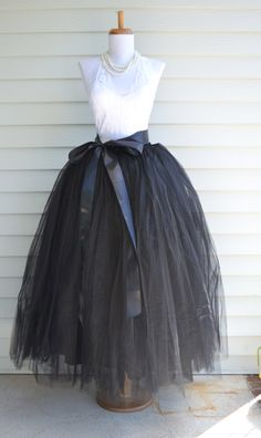 Beautiful tulle skirt in womens sizes. Skirt is made of 6 layers of tulle and is fully lined with an elastic waist. Available in ladies sizes small thru X Large. This is a full, floor length skirt. Sa