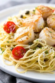 Pan Seared Scallops with Lemon Caper Pasta - Easy gourmet recipe for light angel hair pasta tossed with a citrus white wine sauce and tomatoes. Seafood Pasta Recipes, Fish Recipes, Gourmet Recipes, Dinner Recipes, Cooking Recipes, Sweet Recipes, Simply Recipes, Best Scallop Recipe, Bay Scallop Recipes