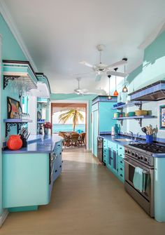 This colorful kitchen is part of an oceanfront home in Anguilla ($3.4 million) built next to a well-known beach, Shoal Bay East. The property includes a three-bedroom four-bath villa, along with a one-bedroom one-bath guest cottage, encompasses several concrete structures designed around five courtyards on a two-acre plot. The total square footage is 8,700, including the guest cottage. (Photo: Tony Cenicola/The New York Times)