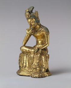 Korean Pensive Bodhisattva, His crown is topped with an orb-and-crescent motif, indicating Central Asian influence. gilt bronze mid-7th C.  H. 8 7/8 in.