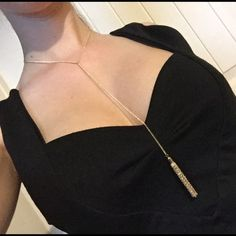 Gold Y Tassel Necklace Brand-new gold necklace with tassel. Chain is 14 inches long with 3 inch extender. From bottom of Y to bottom of tassel is 9 inches. Same day or next day shipping. No trades and no holds. 20% off of bundles. Jewelry Necklaces