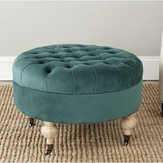 @Overstock.com - Clara Marine Cotton Fabric Round Ottoman - Classic and elegant, the generously padded and tufted Clara round ottoman is crafted from solid wood in pickled oak finish.  http://www.overstock.com/Home-Garden/Clara-Marine-Cotton-Fabric-Round-Ottoman/8419837/product.html?CID=214117 $282.59