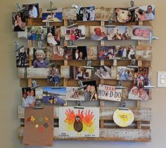 Upcycled wood shipping pallet mounted to the wall and made into a photo board using paper clamps.