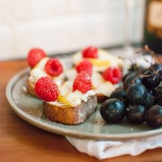 Pear, raspberry and goat cheese crostini topped with a drizzle of ...
