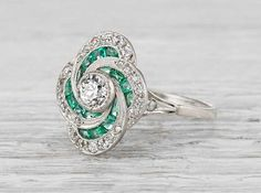 Antique Art Deco ring made in platinum and centered with an approximate .35 carat old European cut diamond. Accented with emeralds and single cut diamonds. Circa 1925. #rings #uniquering #engagementring