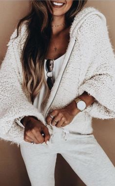 Gorgeous all white outfit! Love that Teddy bear coat! | Stylish office outfits for fashion savvy women from Zefinka.com.