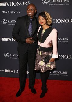 2015 BET Honors - Wayne Brady, the host of this event, poses with his daughter Maile on the red carpet.