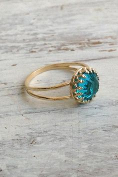 gold ring, blue zircon ring