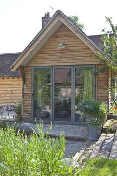 Garden room cladding Bi-fold doors on a home office to complement the nearby conservatory Wood Cladding Exterior, Oak Cladding, House Cladding, Exterior Doors, Outdoor Buildings, Timber Buildings, Garden Room Extensions, House Extensions, Cottage Extension