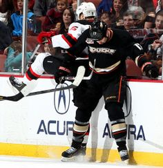 Adam Larsson #5 New Jersey Devils and Dustin Penner #17 Anaheim Ducks