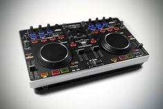 How does  Denon DJ MC2000 compare to Traktor S2?