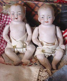 Babies in box//The pair of babies were found in an old Christmas gift box. With them were identical matching suits of clothing.