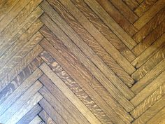 Pulling up a  corner of the Ballroom's wall-to-wall carpeting, the Heather Wells Inc. design team was thrilled to discover the original 1920's oak herringbone flooring.