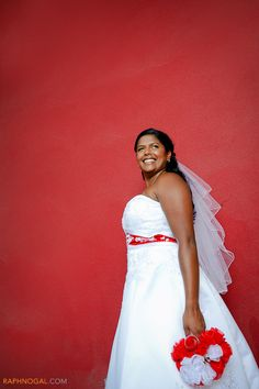 Bride Against Red Wall