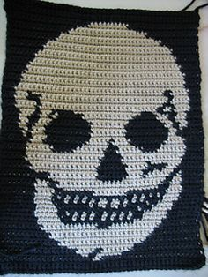 This is an example of what you can do with my skull crochet pattern. Other ideas would be a handbag, pillow, afghan, sweater, backpack, or any other project with the correct row length and stitch w...