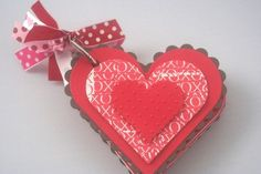 Keep track of special valentines by collecting them together and adding a handmade cover.  (I think you can also get a blank cardstock book at Michaels if you want to make some for friends, too.)