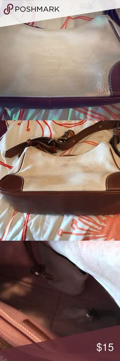 Bourne purse off cream and tan Purse in good condition Med size Dooney & Bourke Bags Baby Bags
