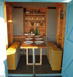 Mod-cons: The kitchen contains a gas hob and kettle, and the table can be pulled out to seat seven people (tiny cabins beach) Beach Hut Interior, Shed Interior, Shed To Tiny House, Tiny House Living, Beach Hut Shed, Beach Huts, George Clarke Amazing Spaces, Stone Cabin, Tiny Cabins