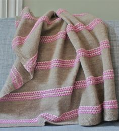 Sugar swirls knitted blanket. I adore the sweet stripe detail and the color combo! - sz