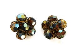 A gorgeous pair of 1960s Brown Aurora Borealis Cluster Earrings. They have brass clip on backs. The earrings measure 2.5cm x 2.5cm. Overall the