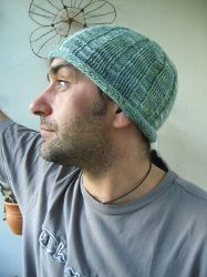 Knit Beanie. My husband is jealous of the baby hats I'm knitting and asked for one of his own.  I like this pattern but will he?