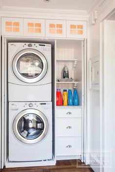 Laundry closet--like the way these doors slide back...interesting idea to stack - do we have enough room?