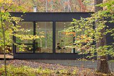 In Situ Studio hides a black cabin in a North Carolina forest