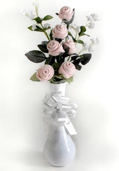 simple, elegant, and can easily fit with any of the themes using fake flowers and baby socks roses