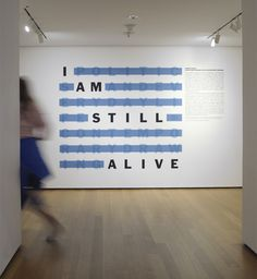 """MoMA exhibition title wall for """"I Am Still Alive: Politics and Everyday Life in Contemporary Drawing"""""""