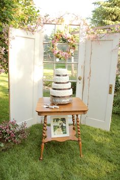 Vintage Cake Table set up | Vintage wedding cake | Blush creme & pink wedding colors | blush cream and pink wedding cake | vintage doors for reception