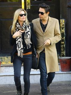 Kate Moss and Jamie Hince  coats scarf sunglasses boots