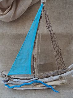 Driftwood sailboat with turquoise sail and netting Driftwood Projects, Driftwood Art, Painted Driftwood, Beach Wood, Beach Art, Wooden Art, Wooden Crafts, Beach Crafts, Summer Crafts