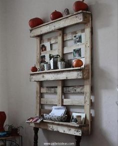 Recycling a multi tiered pallet wood shelf in a small kitchen is just like a perk or an incentive for the dwellers of the house. The issue of storage space is fixed with it pretty effectively. For this kind of shelves you must not bother about the condition of the shipping pallets that you have with you.