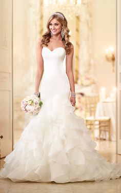 Satin fit-and-flare wedding dress featuring layers of Organza on the skirt and court train with a sweetheart neckline and modern fitted bodice.