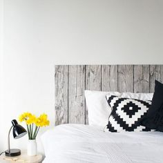 Make a headboard for your bed using this wood-look fabric from Ikea!