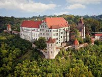 """Trausnitz Castle »Begun in 1204, Trausnitz Castle was rebuilt and enlarged several times over the centuries; arcade courtyard, castle chapel, """"Narrentreppe"""" (fool's staircase) ..."""