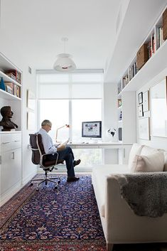 all of the perfect elements for a perfect office - lots of natural light and a view out the window, bookshelves galore, and a comfy couch for when you just don't want to sit at the desk anymore. desiretoinspire.net - Jill Greaves