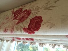 Roman blind in Kate Forman Roses, with a fan edge trim. Handmade by Victoria Clark Interiors.